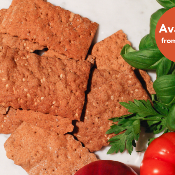Crickelle, crackers made with cricket flour, with a red tomato, onion and basil